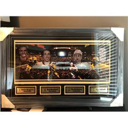 20X32 FRAMED BOSTON BRUINS INCLUDING PATRICE BERGERON, BRAD MARCHAND, CHARLIE McAVOY AND JAKE BeBRUS
