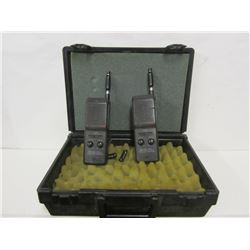 TWO HANDHELD RADIOS AND PADDED PLASTIC CASE