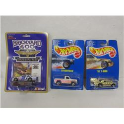 THREE DIE CAST CARS IN UNOPENED PACKAGES