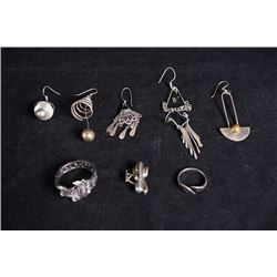 Eight sets of silver jewelries.