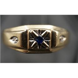 A 10K yellow gold inlaid with small blue diamond and dimonds.