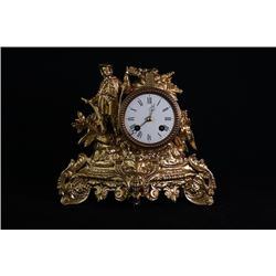 A Gilt clock, small crack on the top.