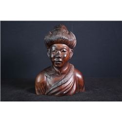 Wood carved a Tibetan figure.