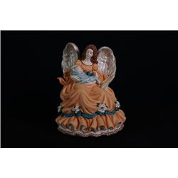 "A ""Guardian Angel"" porcelain figurine."