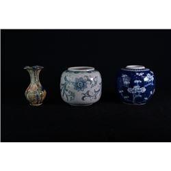 A small vase. A small tea caddy. A small jar.