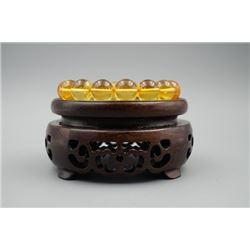 A baltic amber golden bead bracelet.