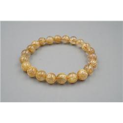 A natural rutilated quartz golden hair bead bracelet.