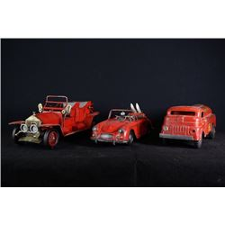 A set of three iron toy cars.