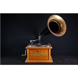 Early 20th century phonograph and radio receiver.