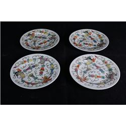 "Four small ""Flora and Butterflies"" plates."