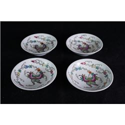 "Four small ""Flora and Butterflies"" dishes."