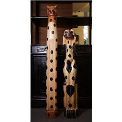 "Two totem poles with ""animals"" pattern."