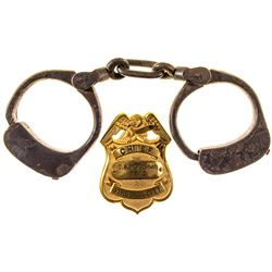 Authentic Virginia City Fire Chief's Gold Plated Badge and Sheriff's Handcuffs from Charles McGuigan