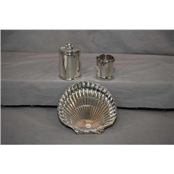 Three pieces of sterling silver including Birks shell dish, small sterling cup, and a International