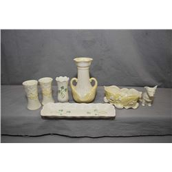 "Selection of Belleek pottery, various patterns including black mark shamrock 4"" bud vase, small corg"