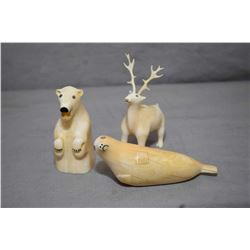 "Three Inuit carvings including very animated bear 3"" in height, very full walrus and a surprised dee"
