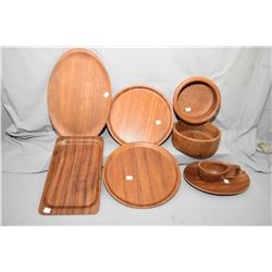 Selection of mid century designed wooden serving trays and bowls including teak, mahogany etc.
