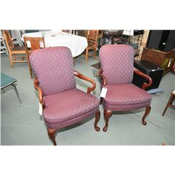 Pair of open parlour chairs with purple upholstery on tall cabriole supports