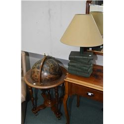 Globe motif bar and book motif table lamp with shade