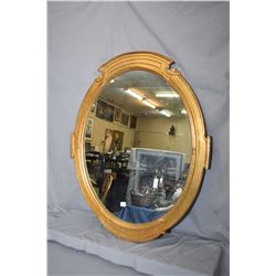 "Gilt framed oval wall mirror, overall dimensions 33"" X 29"""