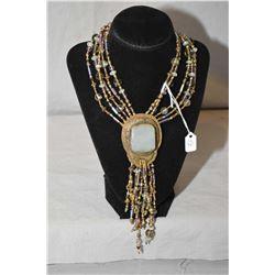 Vintage David Navarro five strand beaded necklace with large brass center concho style medallion, se