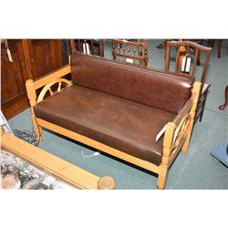 Small wagon wheel motif upholstered settee