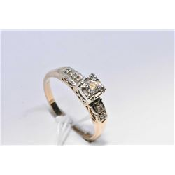Lady's antique 14kt yellow and white gold diamond engagement ring