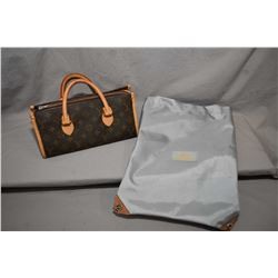 Louis Vuitton hand bag with replaced after market zipper and a Louis Vuitton Cup bag from the 2000 y