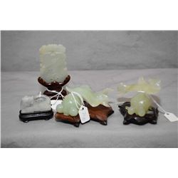 """Four carved Oriental jadeite figures on rosewood bases including goldfish 1 3/4"""" in height plus tabl"""