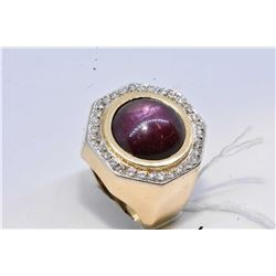 Gent's 14kt yellow and white gold ring set with cabochon star ruby gemstone and surrounded by brilli