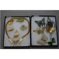 Two trays of butterfly motif jewellery including rhinestone and enamelled brooches, earrings and nec