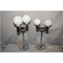 Two mid century chrome space age table lamps