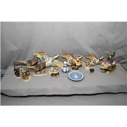 Tray lot of porcelain collectibles including Beswick birds, Hummel figurines, Royal Crown Derby shak