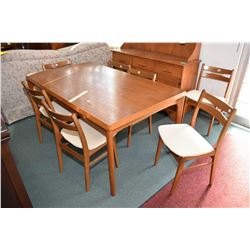 Danish made mid century teak draw leaf dining table and seven dining chairs