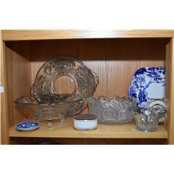 Shelf lot of glass and porcelain collectibles including silver overlay serving dishes and candlestic