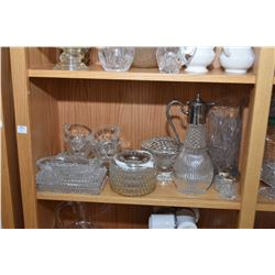 Shelf lot of glassware including large pitcher, cruet, butter churn, cream and sugar etc.