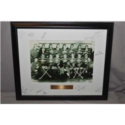 Vintage promo photo of the 1952 Canadian gold metal Olympic team from Oslo, matting signed by severa