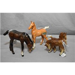 "Three small Beswick horse figures including brown foal 3 1/4"" in height, cream colour palomino and a"