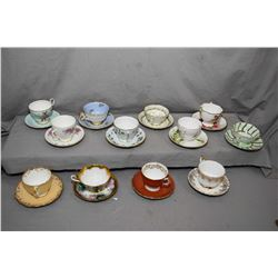 Selection of collectible china cups and saucers including Adderley, Paragon, Colclough, Queen Anne,