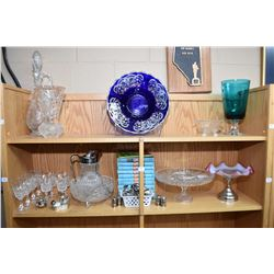 Two shelf lot of collectibles including cobalt glass and silver overlay bowl, crystal stemware, crys