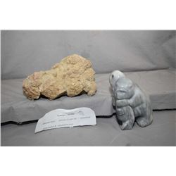 "Piece of genuine coprolite 10"" in length and a multi figured carved soapstone signed Chief Carver 20"