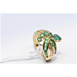 Lady's 18kt yellow gold, diamond and emerald ring set with .25ct pear shaped emerald, 0.32ct of mell