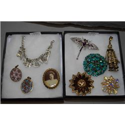 Two small trays of vintage and collectible jewellery including silver charm bracelet, two millifore