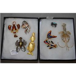 Two trays of collectible vintage sea creature motif brooches including rhinestone lobster with movin
