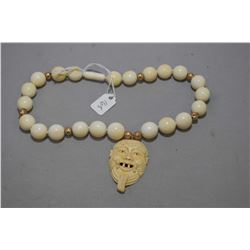 Oriental elephant ivory beaded necklace with carved ivory face