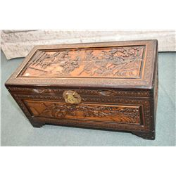 Carved camphor wood chest with Oriental pictorial scenes of horse and riders plus inner tray