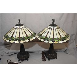 Pair of cast Art Nouveau style table lamps with leaded and stained glass dragon fly motif shades