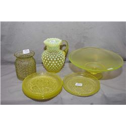 Seven pieces of vintage Uranium glass including four side plates, comport, hobnail pitcher and vase