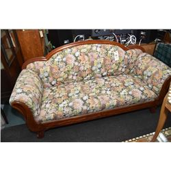 Regency style full sized sofa with floral upholstery and carved show wood