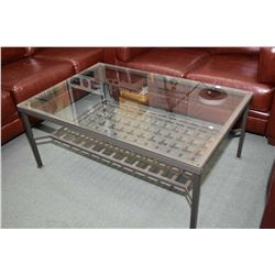 Metal and glass top coffee table with lattice work metal under shelf